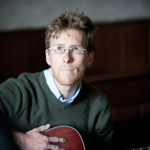Simon de Voil playing guitar